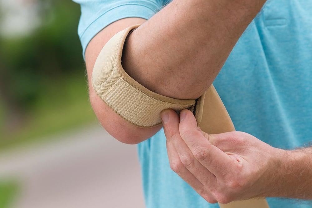 Skydd för tennisarmbåge (padelarmbåge)
